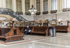 Hoboken Train Station Waiting Room. Hoboken, NJ USA -- September 19, 2017 The waiting room for the Hobaoken train station. A man is alseep on one of the benches Stock Photo
