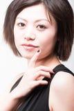 Hoch-Taste Asiatfrau Stockbilder