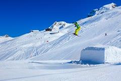 HOCH YBRIG, SWITZERLAND - February 26, 2015 - Flying skier skiin Stock Photography