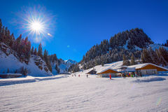 HOCH-YBRIG, SWITZERLAND - February 26, 2015- Skiers skiing on sk Stock Image