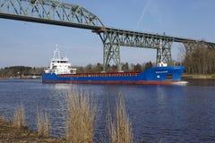 Hochdonn – General cargo vessel Fehn Caledonia at the Kiel Canal Royalty Free Stock Photo
