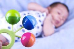 Hochet coloré de bébé Photos stock