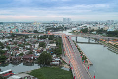 Hochiminh Vietnam. August 29, 2014: View of the Nguyen Van Cu Bridge and Saigon River at sunset in Hochiminh City, Vietnam Stock Photo