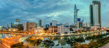 Hochiminh Vietnam. July 18, 2014: View of the central city middle across the Saigon River in the city of Hochiminh Vienam Royalty Free Stock Photo