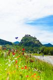 Hochosterwitz castle in Austria among poppy flowers Royalty Free Stock Photos