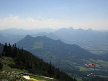 On a Hochries mountain in Alps. A view with air perspective with hills and peaks Stock Photography