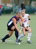 Hochschulfeld-Hockey - Damen Stockfotos