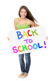 Hochschulstudentholding zurück zu Schulezeichen Stockfotografie