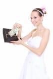 Hochzeitsausgabenkonzept. Braut mit Geldbeutel und einem Dollar Stockfotografie