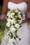 Hochzeitsbraut und -blumenstrauß Stockfoto