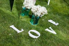 Hochzeitsdekoration von Blumen Lizenzfreie Stockfotos