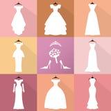 Hochzeitsikonen Kleider silhouettieren Satz Mode flach Stockfotografie