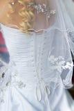 Hochzeitsschleier und -korsett stockfotos