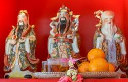 Hock Lok Xiu. Tribute for Three Chinese lucky gods,Fu Lu Shou statues, or Hock Lok Xiu on ,focusing on orange Stock Image