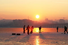 Hockey. On sunset on the winter river Royalty Free Stock Photography