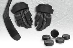 Hockey gloves, putter and washers on the ice of the hockey arena. Hockey accessories on ice on the ice of the hockey arena. Concept, hockey stock photos