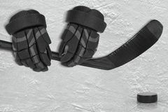 Hockey Accessories on Ice Arena. Hockey gloves, putter and washer on the ice of the hockey field. Concept, hockey Royalty Free Stock Image
