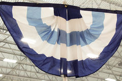 Hockey Arena banner. A Banner hanging in a hockey arena. you can see the rafters and lights on the ceiling stock photos