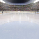 Hockey Arena With Fans in the Stands and Copy Space. On ice low-angle view of hockey arena full of fans in the stands with copy space. Deliberate focus on royalty free stock image