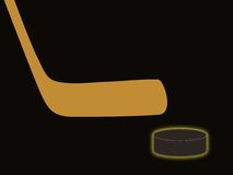 Hockey attributes. On a black background (a stick and a washer Royalty Free Stock Photography