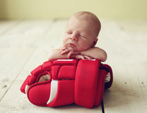 Hockey Baby. Cute newborn baby boy sleeping on a hockey glove Stock Photography