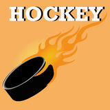 Hockey. Ball on fire on orange background Royalty Free Stock Image