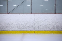 Hockey boards. A straight on shot featuring well worn hockey boards in a recreational hockey rink royalty free stock photo