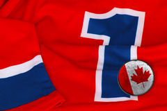 Hockey Canada jersey and washer Royalty Free Stock Photography
