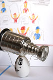 Hockey Champion Trophy Holder. A character hockey champion celebrates his stanley cup playoff win royalty free stock image