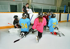 Hockey Coach with Players at Practice Stock Images