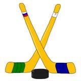 Hockey con el palillo y el duende malicioso Fotos de archivo