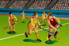 Hockey de terreno de juego de la gente en la competencia Imagen de archivo libre de regalías
