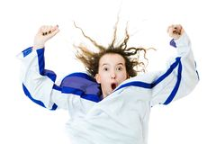 Hockey fan in jersey in color of Finland cheer, celebrating goal. Raising hands up- white background stock photography