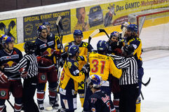 Hockey fight. ZELL AM SEE, AUSTRIA - DECEMBER 7: Austrian National League. Marc Brown trying to fight Salzburg player. Game EK Zell am See vs. Red Bulls Salzburg stock image