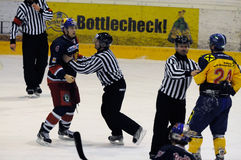 Hockey fight. ZELL AM SEE, AUSTRIA - DECEMBER 7: Austrian National League. Referees stopping fight between Schernthaner and Mitterdorfer. Game EK Zell am See vs stock photo