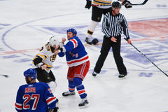 Hockey Fight. Rangers' Colton Orr taken on the Bruins' Thornton during a Rangers 4-3 victory over Boston Royalty Free Stock Images