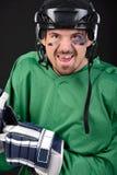 Hockey. Funny hockey player smiling, bruise around the eye. Black background stock images
