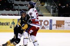 Hockey game. ZELL AM SEE, AUSTRIA - FEB 1: Austrian National League. Brunnegger hits Zell am See player. Game EK Zell am See vs. ATSE Graz (Result 4-1) on stock photo