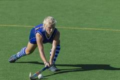 Hockey Girl Sweep Ball Stock Photos