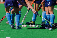 Hockey Girls Sticks Balls Astro Colors Stock Image