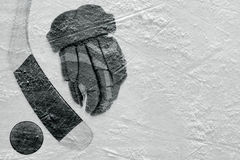 Hockey glove, stick and puck Royalty Free Stock Images