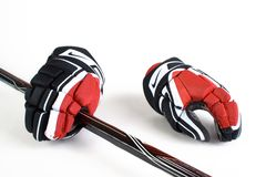 Hockey gloves. Photo from hockey gloves, with stick, and white background Royalty Free Stock Photos
