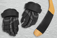 Hockey gloves and stick Royalty Free Stock Images