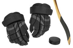 Hockey gloves, stick and puck Royalty Free Stock Images