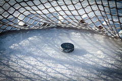Hockey goal. Ic hockey puck in net after crossing goal line Royalty Free Stock Photos