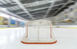 Hockey Goal Seen From Behind in Hockey Rink. Hockey goal hockey net hockey rink ice hockey hockey arena ice rink indoors Royalty Free Stock Photography