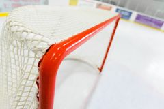 Hockey Goal Seen From Behind in Hockey Rink. Hockey goal ice hockey ice rink indoors blurred motion hockey rink hockey net Stock Photography