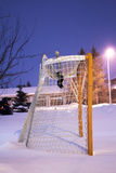 Hockey goal. An hockey goal under snow on a hockey rink in the night Royalty Free Stock Image