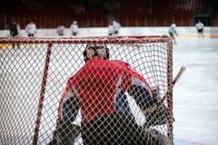 Hockey goalie protects gate Stock Photography