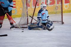 Hockey goalkeeper of amateur team at the gate before the start of the game . royalty free stock images